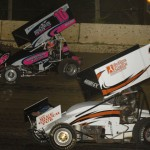 Jimmy Hurley (35) and Jeremy Standridge battle during Wednesday's Midwest Open Wheel Ass'n feature at Highland (Ill.) Speedway. (Mark Funderburk Photo)