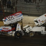 Jerrod Hull (12) battles Greg Wilson during Wednesday's Midwest Open Wheel Ass'n event at Highland (Ill.) Speedway. (Mark Funderburk Photo)