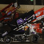 Jimmy Light (23), Cory Bruns (42) and Paul Nienhiser during Wednesday's Midwest Open Wheel Ass'n feature at Highland (Ill.) Speedway. (Mark Funderburk Photo)