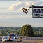 The Starworks Motorsports No. 8 shared by Brendon Hartley and Scott Mayer crosses the finish line to win Saturday's Grand-Am Rolex Sports Car Series race at Road America. (Grand-Am Photo)