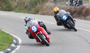 Chris Palmer (9) leads Cameron Donald on his way to winning the 350cc Classic TT race on Monday. (Dave Kneen Photo)