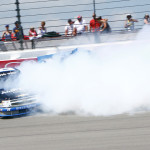 Max Gresham spins and throws up a cloud of smoke that also claims Darrell Wallace Jr. and Johnny Sauter during Saturday's NASCAR Camping World Truck Series race at Michigan Int'l Speedway. (HHP/Alan Marler Photo)