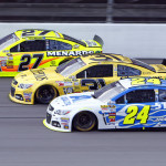 Paul Menard (27), Jeff Burton (31) and Jeff Gordon battle three-wide during Sunday's NASCAR Sprint Cup Series race at Michigan Int'l Speedway. (HHP/Alan Marler Photo)