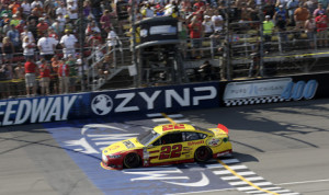 Joey Logano crosses the finish line to win Sunday's Pure Michigan 400 at Michigan Int'l Speedway. (HHP/Harold Hinson Photo)