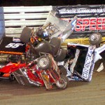 Austin McCarl, James McFadden, Rager Phillips, Robbie Wolfgang and Tim Shaffer were all involved in this wild crash on the opening lap of the 25-lap Knoxville Nationals preliminary feature Friday at Knoxville Raceway. (Hein Brothers Photo)