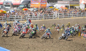 The Lucas Oil Pro Motocross field charges into the first turn during the 2013 Red Bull Lake Elsinore National in California. (Simon Cudby Photo)