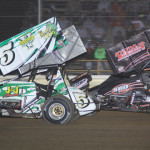 Jordan Ryan (5) battles eventual winner Nate Dussel during 305 sprint car competition at Ohio's Attica Raceway Park. (Action photo)