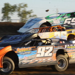 Cody Scott, Matt Irey (36) and John Mayes Jr. (69) battle for position during a late model heat race at Attica (Ohio) Raceway Park. (Action photo)