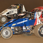 Bryan Clauson (20), Chad Boespflug (57) and Casey Shuman during Friday's AMSOIL USAC National Sprint Car Series feature at Kokomo (Ind.) Speedway. (Dave Heithaus Photo)