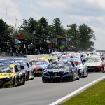 Marcos Ambrose (9) leads the NASCAR Sprint Cup Series field into turn one during Sunday's event at Watkins Glen (N.Y.) Int'l. (Joe Proietti Photo)