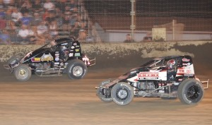 Dave Darland (71p) races around Kevin Thomas Jr. en route to victory Friday night at Kokomo (Ind.) Speedway. (Gene Crucean photo)