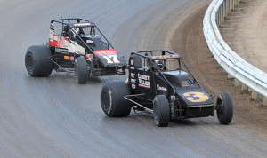 A.J. Fike (3) battled by Chris Windom (17) to win Saturday's Traxxas USAC Silver Crown Series Tony Bettenhausen 100 at the Illinois State Fairgrounds. (Gene Crucean Photo)