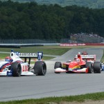 Jack Hawksworth (77) leads Carlos Munoz during Sunday's Firestone Indy Lights race at the Mid-Ohio Sports Car Course. (Dave Heithaus Photo)