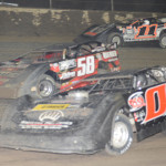 Dewayne Keifer (0), Ray Goss Jr. (58) and Tyler Reddick jockey for position during the UMP vs. MARS dirt late model event at Federated Auto Parts Raceway at I-55 in Pevely, Mo. (Don Figler photo)