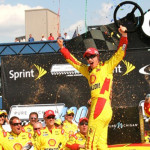 Joey Logano celebrates after winning Sunday's NASCAR Sprint Cup Series race at Michigan Int'l Speedway. (Robert Benko Photo)