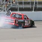 James Buescher celebrates after winning Saturday's NASCAR Camping World Truck Series race at Michigan Int'l Speedway. (Robert Benko Photo)