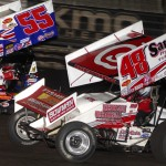 Danny Dietrich (48) works below Brooke Tatnell during action Friday at Knoxville (Iowa) Raceway. (Doug Johnson Photo)