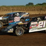Six-time track champion Nick Allen (21) battles with Jordan Danford (88) during early evening heat race action at Shadyhill Speedway in Medaryville, Ind. (Stan Kalwasinski photo)