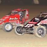 Kevin Thomas Jr. (17rw) battles Jerry Coons Jr. during Thursday's AMSOIL USAC National Sprint Car Series event at Kokomo (Ind.) Speedway. (Gordon Gill Photo)