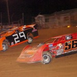 Russ King (56) races under Garrett Krummert during the late model feature at Pennsylvania's Lernerville Speedway. (Hein Brothers photo)