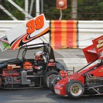 Todd Bertrand (39) powers past Russ Stoehr in the Angelillo family's Dumo's Desire No. 45 en route to wining the Gene Angelillo Memorial NEMA midget race at Waterford (Conn.) Speedbowl. (Norm Marx photo)