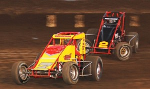 Cory Kruseman (7) races under Austin Williams Saturday night at Perris (Calif.) Auto Speedway. (Doug Allen photo)