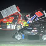 Eventual NEMA midget winner John Zych (9) battles Paul Scally at Riverside Speedway in Groveton, N.H. (John Dadalt photo)