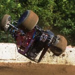 Stuart Hanft flips his sprint car during hot laps at Plymouth (Ind.) Speedway. (Gary Gasper photo)