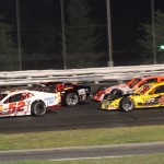 Doug Coby (52) and Bobby Santos III (44) lead the NASCAR Whelen Modified Tour field during a restart Friday at Stafford Motor Speedway. (Dick Ayers Photo)