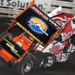 Brad Loyet (05) gets up on two wheels after contact with Danny Dietrich during Friday's Knoxville Nationals preliminary action at Knoxville (Iowa) Raceway. (Frank Smith Photo)