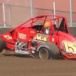 Shane Cockrum crashes during hot laps prior to Saturday's 100-lap Traxxas USAC Silver Crown Series race at the Illinois State Fairgrounds. (Gordon Gill Photo)