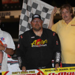 Terry Phillips stands in victory lane after winning Friday's United States Modified Touring Series event at Lakeside Speedway. (Ivan Veldhuizen Photo)