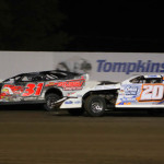 Rodney Saunders (20) races with Corey Dripps during Friday's United States Modified Touring Series feature at Lakeside Speedway. (Ivan Veldhuizen Photo)