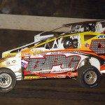 Duane Howard (4) charges around Nate Christman during modified competition at Pennsylvania's Grandview Speedway. (Rich Kepner photo)