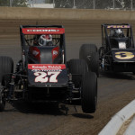 Jerry Coons Jr. (27) battles eventual race winner A.J. Fike during Saturday's Traxxas USAC Silver Crown Series race at the Illinois State Fairgrounds. (Mark Funderburk Photo)