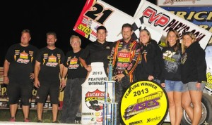Brian Brown along, with fans and crew, celebrate after winning the Jackson Nationals. (ASCS / Rob Kocak)