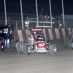 Davey Ray (1), Brad Kuhn (57) and Darren Hagen during the Pepsi Nationals at Angell Park Speedway. (Bob Cruse Photo)