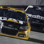 The damaged machines of Jeff Burton (31) and Jimmie Johnson during Sunday's NASCAR Sprint Cup Series race at Atlanta Motor Speedway. (HHP/Brian Lawdermilk Photo)