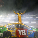 Kyle Busch celebrates after winning Sunday's NASCAR Sprint Cup Series race at Atlanta Motor Speedway. (HHP/Brian Lawdermilk Photo)