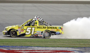 Kyle Busch celebrates after winning Friday's NASCAR Camping World Truck Series race at EnjoyIllinois.com 225 at Chicagoland Speedway. (HHP/Alan Marler Photo)