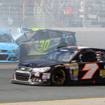 Jamie McMurray (1) and Kevin Swindell (30) crash as Dave Blaney (7) passes by during Sunday's NASCAR Sprint Cup Series race at New Hampshire Motor Speedway. (HHP/Alan Marler Photo)