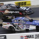Robert Hight (near lane) beats Cruz Pedregon during his run to victory in the NHRA Funny Car class at zMAX Dragway on Sunday. (HHP/Gregg Ellman Photo)