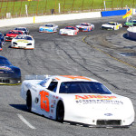 Colt James (15) leads a pack of cars during PASS South competition at Hickory Motor Speedway this season. (Chris Owens Photo)