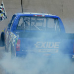 James Buescher celebrates after winning Sunday's NASCAR Camping World Truck Series race at Iowa Speedway. (NASCAR Photo)