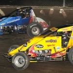 Bryan Clauson (20) and Tracy Hines jockey for position during USAC sprint car action at Eldora Speedway. (Frank Smith photo)