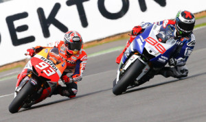 Marc Marquez (93) battles eventual race winner Jorge Lorenzo during Sunday's MotoGP event at Silverstone Circuit. (MotoGP Photo)
