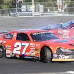 Wayne Helliwell Jr. (27) goes for a spin off the bumper of Brian Hoar. Helliwell managed to recover to claim the 2013 American Canadian Tour championship at Airborne Speedway. (Leif Tillotson Photo)