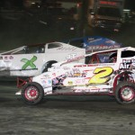 Bryan King (X) battles Adam Pierson during the modified feature at Vermont's Bear Ridge Speedway. (Alan Ward photo)