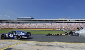 Jimmie Johnson and Tony Schumacher performed side-by-side burnouts Wednesday afternoon at Charlotte Motor Speedway. (CMS photo)