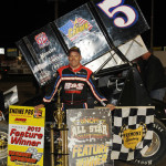 Byron Reed stands in victory lane after winning Friday's UNOH All Star Circuit of Champions feature at Fremont (Ohio) Speedway. (Julia Johnson Photo)